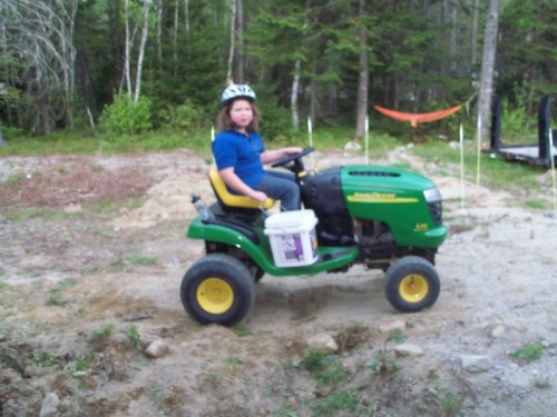 Hannah cruising on her tractor
