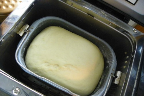 Letting the bread machine knead the dough